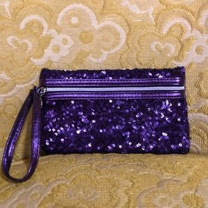 Purple sequined wristlet. NWOT